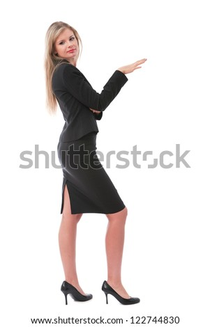 Young business executive in skirt posing at camera - stock photo