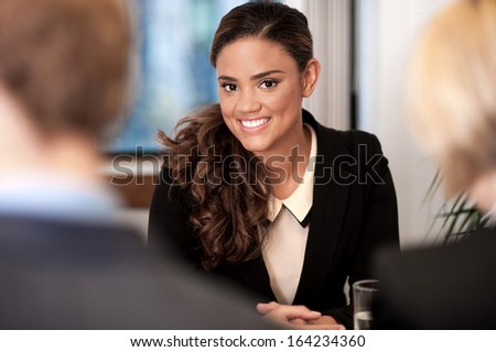 Young business executives in a meeting - stock photo