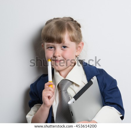 young business girl in a strict office suit