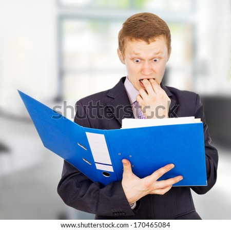 young business guy surprised is in the office - stock photo