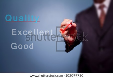 Young business hand with pen mark the check boxes. - stock photo