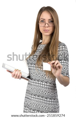 Young business lady gives business card. Smiling young Caucasian female passes blank business card. She keeps tablet PC in another hand.  Focus on hand with business card, white background - stock photo