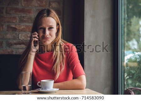 Young business lady having a break in coffee shop
