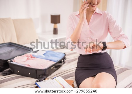 Young business lady hurring up to meeting and talking by phone. Close-up. - stock photo