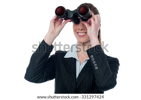 Young business lady looking through binocular