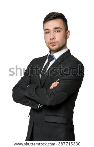 Young business man, arms crossed his chest, isolated on a white background