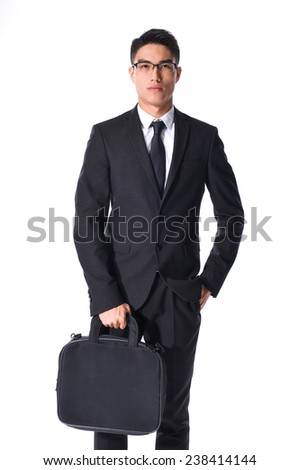 young business man carrying a suitcase , Vertical shot. - stock photo
