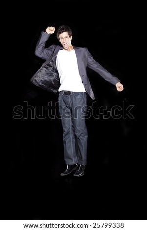 Young Business Man Cheering and Jumping - stock photo