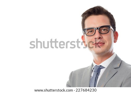Young business man close up over white background. Looking confident - stock photo