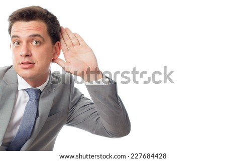 Young business man close up over white background. Paying attention - stock photo