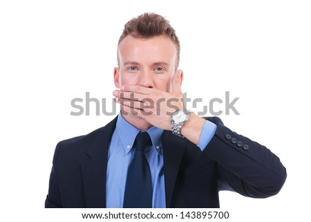 young business man covering his mouth with his hand. speak no evil. on white background - stock photo