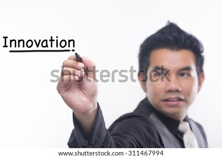 Young business man draws a word innovation - stock photo