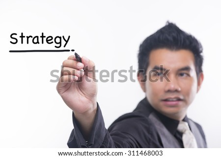 Young business man draws a word strategy