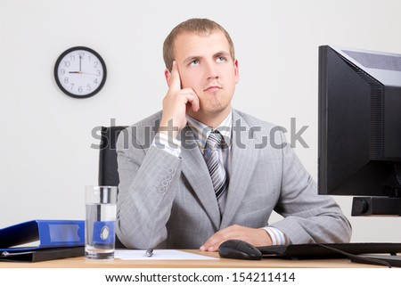young business man dreaming at workplace - stock photo