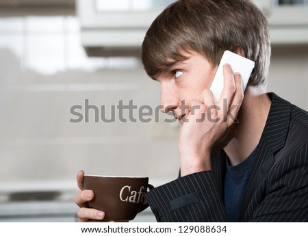 young business man drink a cup of coffee in the kitchen - stock photo