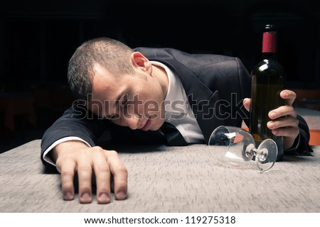 Young business man drunk felt asleep with red wine. - stock photo