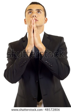 Young business man folding his hands for a prayer