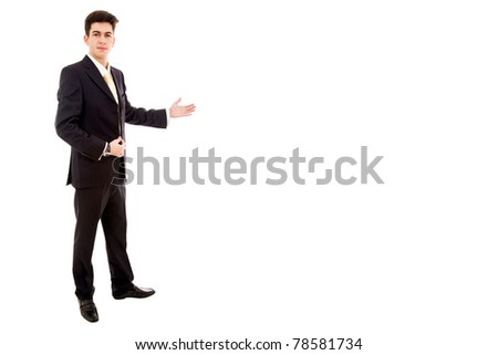 young business man full body presenting over a white background