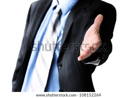 Young business man giving hand for handshake - stock photo