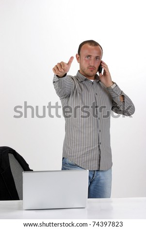 young business man going thumb up, isolated on white
