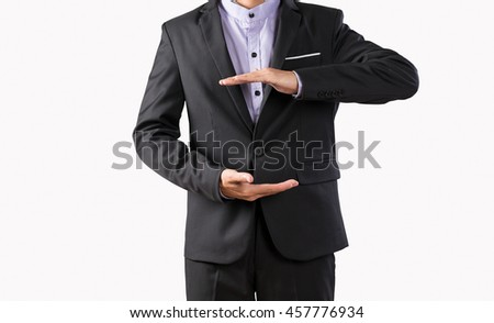 Young business man hands holding or protect something, portrait in studio shot of photography.