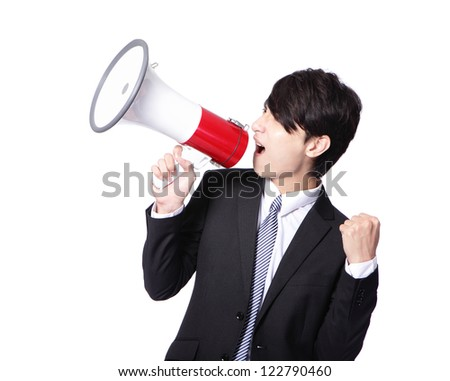 Young business man happy shouting into a megaphone and show his fist isolated over a white background, asian model