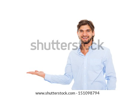 young business man happy smile hold open palm to empty copy space, Handsome businessman showing pointing side, concept of advertisement product, isolated over white background - stock photo
