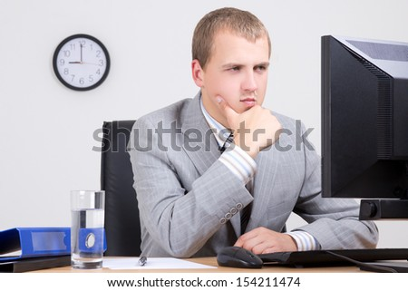 young business man having a problem at work - stock photo