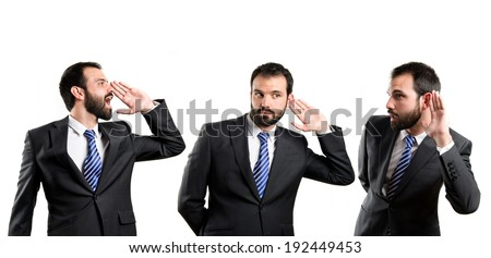 Young business man hearing and screaming over white
