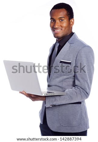 Young business man holding a laptop on white background