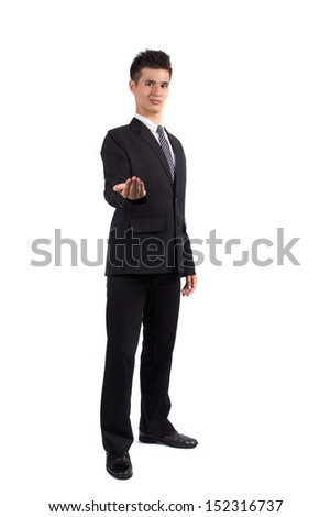 Young business man holding hand presenting a product. isolate on white background