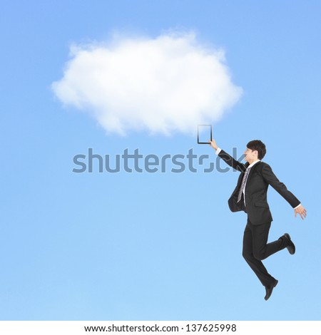 Young business man holding touch pad and jump to clouds, cloud computing concept, asian model - stock photo