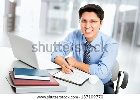 Young business man in an office