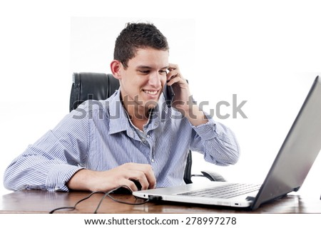 Young Business man in his office - stock photo