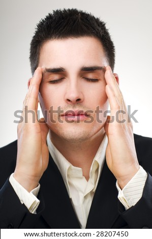 young business man in stress close up - stock photo