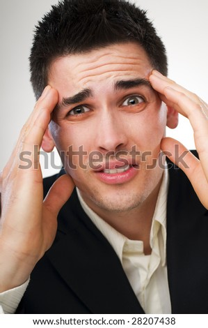 young business man in stress close up shoot - stock photo