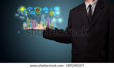 Young business man in suit presenting colorful hand drawn metropolitan city