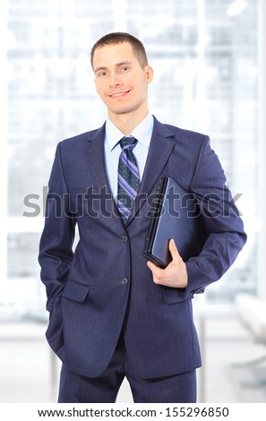 young business man isolated on white background - stock photo