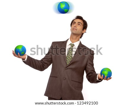 young business man juggling with earth