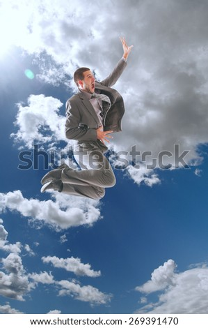 Young business man jumping in the air