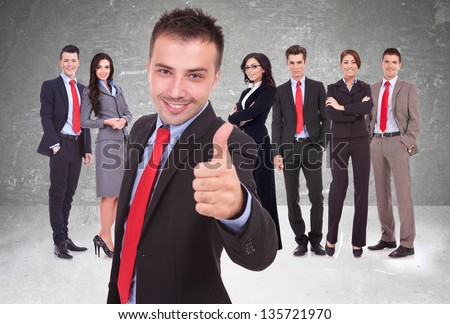 young business man leader of a successful team making the thumbs up ok gesture - stock photo
