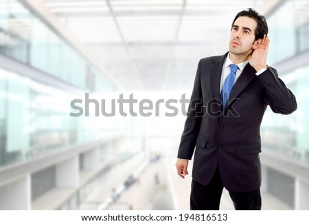 young business man listening at the office