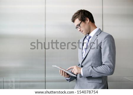 Young business man looking at a digital tablet  - stock photo