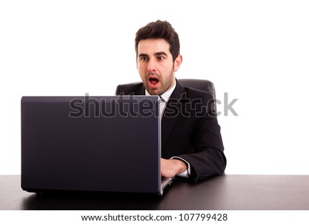 Young business man looking at screen computer with a excited expression, isolated on white - stock photo