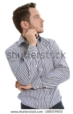 Young business man looking pensive away. - stock photo