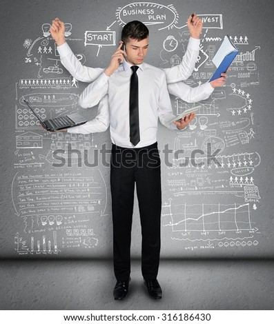 Young business man multitasking concept - stock photo