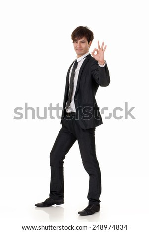 Young business man of Asian, full length portrait on white background.