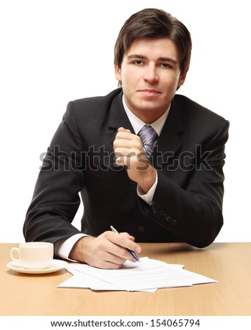 young business man on a desk, isolated on white background - stock photo