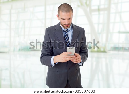 young business man on the phone, at the office - stock photo