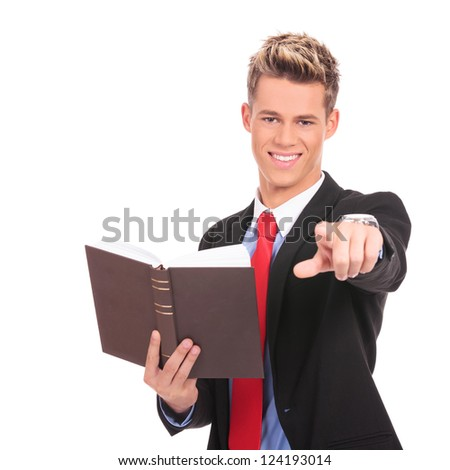young business man or law student reading and giving the ok for the book